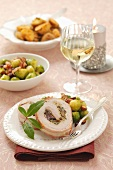 Pork roulade with a mushroom filling, brussels sprots and baked potatoes