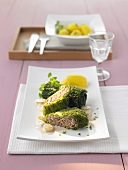 Savoy cabbage parcels with grape sauce