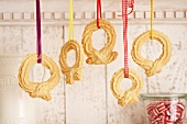 Biscuit rings hanging up as Christmas decorations