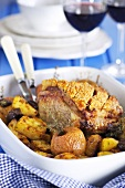Roast pork with apples and potatoes