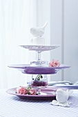 A cake stand made of individual plates and glasses