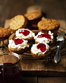 Pumpkin muffins with cream cheese and jam on cake rack