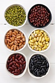 Various types of beans in small dishes