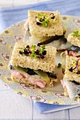 Fish roe paste and rollmop sandwiches with radish sprouts