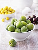 Greengages, cherries and mirabelles in bowls