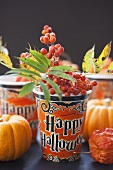 Paper cup with rowan berries (Halloween)