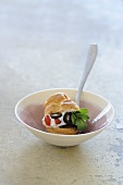 Profiterole filled with ricotta, cherry tomatoes and olives