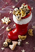 Santa's boot with assorted Christmas biscuits