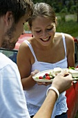Young couple eating panna cotta with berries