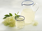Elderflower lemonade in jug and glass