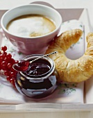 Redcurrant jelly, croissant and milky coffee