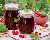Bottled and fresh raspberries
