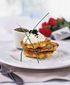Potato pancakes with sour cream and caviar