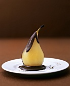 Poached pear with chocolate sauce and pepper