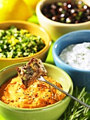 Lamb fondue with rosemary and dips