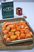Sweet potatoes with coriander on a baking tray