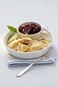 Pierogi (steamed dough parcels) filled with herring with a beetroot salad