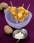 Roast potatoes on skewers with the garlic dip