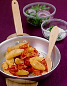 Fried Bamberg potatoes with red peppers
