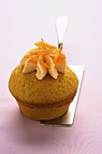 Carrot muffin on cake server