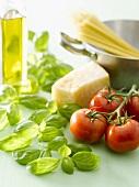 Basil, tomatoes, Parmesan, spaghetti and olive oil
