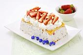 Cassata with whipped cream and fresh strawberries