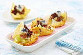 Chicory salad with feta, bacon, poppy seeds in Parmesan baskets