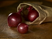 Red onions with paper bag