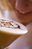 Girl drinking tiramisu coffee