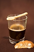 Espresso with spoon-shaped biscuit and biscotti
