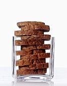 Slices of rye bread in a square glass