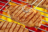 Beef steaks on barbecue