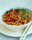 Stir-fried noodles, chicken and vegetables