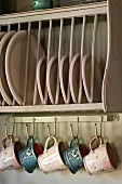 Plates in rack and cups hanging on hooks