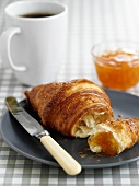 Croissant with marmalade and coffee