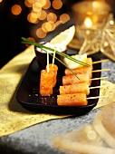 Smoked salmon on cocktail sticks for Christmas