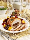 Christmas turkey breast wrapped in bacon with date and plum stuffing