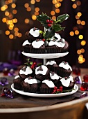 Christmas pudding muffins on a cake stand with holly