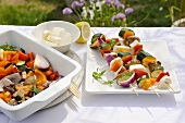 Vegetable kebabs for the barbeque on a table in the open air