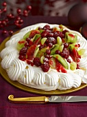 Pavlova with berries and kiwis for Christmas