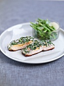 A parsley and tarragon mixture on salmon