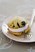 Whoopie Pie with blueberries on a plate with a fork