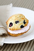 Whoopie Pie with blueberries on a plate with a cloth napkin