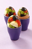 Vegetables in aspic with quail's eggs in egg cups