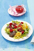 Frisee salad with chicken liver, orange, raspberries and raspberry dressing