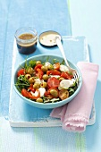 Rocket salad with cherry tomatoes, mozzarella, peppers, olives and balsamic dressing