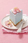 A slice of blue cheese cake with rose petals