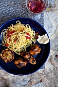 Grilled chicken with spaghetti and lemons