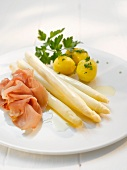 White asparagus with ham and parsley potatoes