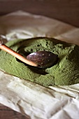 Stevia powder with a slotted spoon